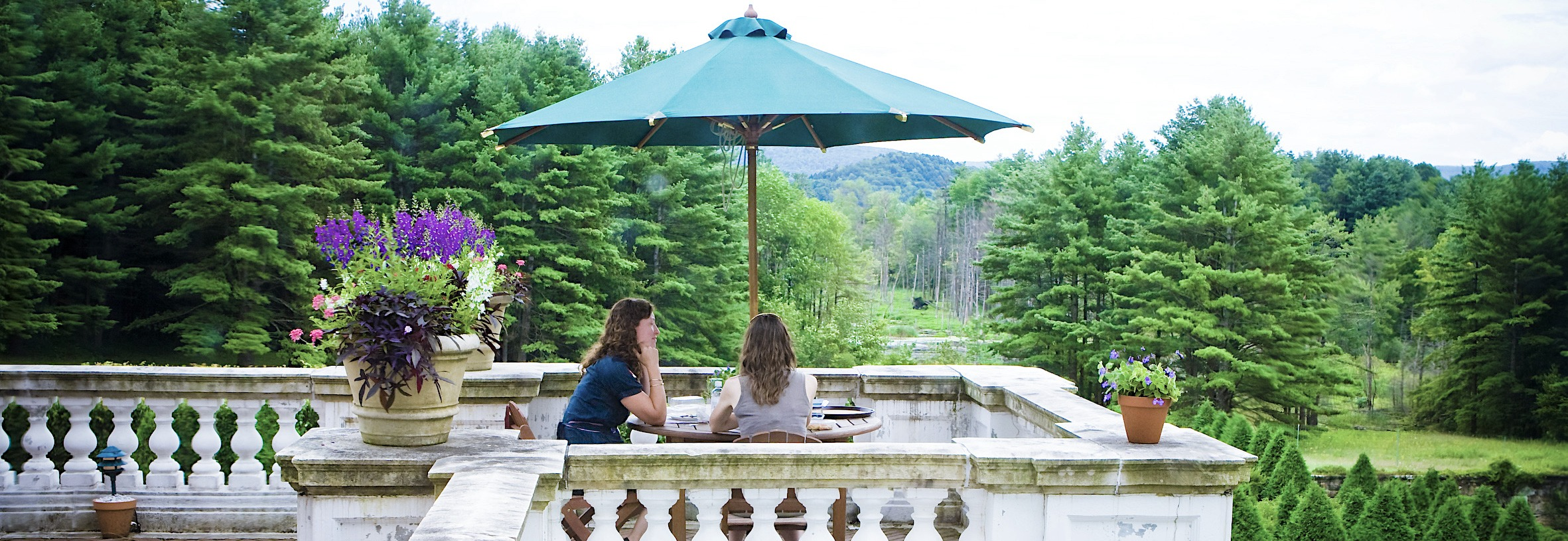 Two women dining on the terrace at the Mount