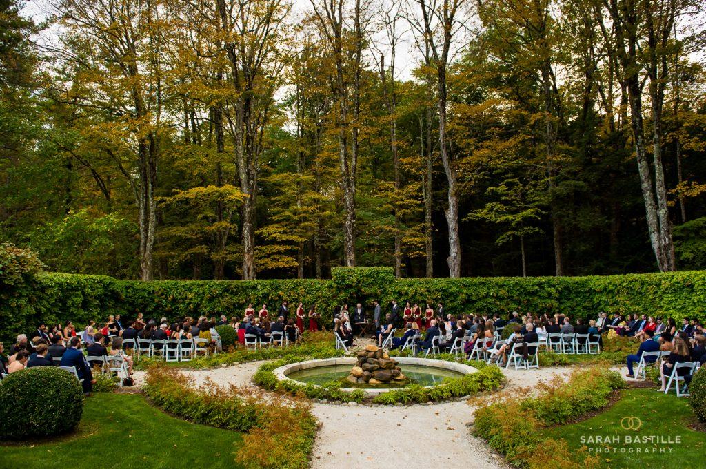 Wide shot of wedding guests sitting in the Italian Garden.